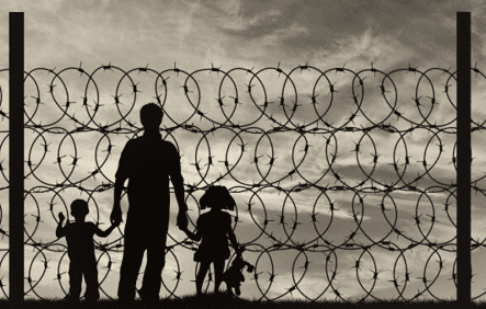 family behind barbed wire